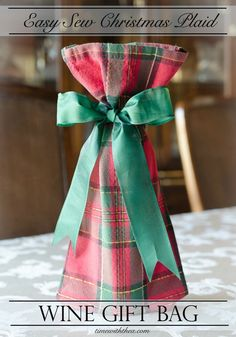 Wine Gifts - Easy Sew Christmas Plaid Wine Gift Bag ~ Step-by-step photo tutorial showing how to make a wine gift bag with same-side Christmas plaid tablecloth fabric. An easy and fun handmade gift to make for the holiday season! / timewiththea.com
