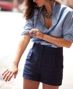 How to achieve the perfectly effortless cuffed sleeve: keep the top button (which is called the gauntlet) buttoned while you roll.