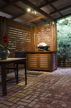 Recently built this BBQ area under our verandah. The horizontal slats on the… Hut House, House Yard, Outside Patio, Back Patio, Deck Kitchen Ideas, Bbq Stand, Bbq Area, Cabinet Doors, Outdoor Bars