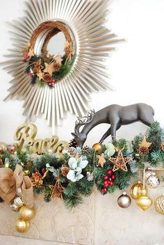Hang ornaments from varying lengths of ribbon on evergreen garland to create depth and beauty.