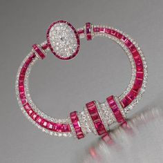 A rare art deco ruby and diamond fibula brooch, by Georges Fouquet, c. 1925.