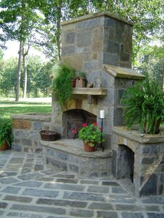 Outdoor fireplace and seating. If anyone wants to go to my cottage and build this for me I wouldnt object!!!