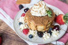 A pile of fluffy buttermilk pancakes topped generously with lotus biscoff spread, served up with vanilla icecream / whipped cream, lotus biscuit crumbles and lots of fresh berries. Lotus Biscoff Spread, Lotus Biscuits, Biscoff Biscuits, Buttermilk Pancakes Fluffy, Pancake Day, Egg Whisk, Mixed Berries, Salted Butter, Baking Soda