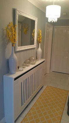 Hallway, grey, white and yellow. really pleased with the result! the radiator Hallway Cabinet, Hallway Mirror, Upstairs Hallway, Cabinet Decor, Hallway Shelf, Grey And White Hallway, Yellow Hallway, Hallway Colours, Flat Hallway Ideas