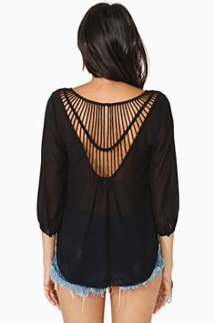 Elegant. Opened-ish cris cross upper back black blouse.