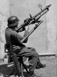 A German soldier making an Anti-aircraft weapon of his MG 34.