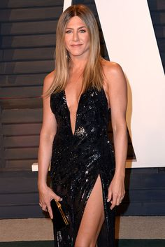 Jennifer Aniston in a black Atelier Versace gown and Gucci 'Mallory' sandals at the 2017 Vanity Fair Oscar Party