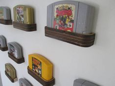 I'm going to lose access to a laser engraver soon, so I created a new Etsy listing so others can use my design. DIY N64 Cartridge Display Shelf // Files to Laser Engrave and Assemble