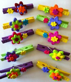 Floral Clothespin Bulletin Board Pins...  Craft paint and buttons from Walmart and a little hot glue turn ordinary clothespins into a colorful way to display student work.