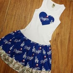 Tank Style Dresses run very true to size. The tanks are ribbed so they will stretch or conform to the shape of your child. There is a Dodgers heart applique on the chest of dress. Tank dresses start at 6mo through 12/14.  Onesie dresses available NB - 12mo (please contact me for a custom listing for this item.)  Please do not hesitate to message me for any questions on what size would be best for you.  All of my items are handmade upon receiving your order.