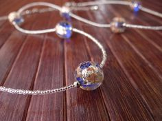 ANNA  Murano glass parure di VenetianPearls su Etsy.  In this necklace the transparent turquoise Murano glass beads are created using gold leaf and avventurine melted in the bead itself. A thread of small crystal-colored beads separate the beads regularly creating a modern and elegant effect suited for any day.