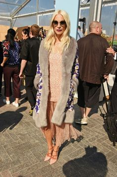 8754ae3dc6de Poppy Delevingne wears a floral matching set with a printed fur coat