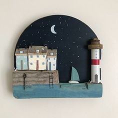 Night time, wall plaque,the back is a vintage clock door, and a 1930's bobbin for the lighthouse #lorainespick #shabbydaisies #shabbychic #lighthouse #driftwoodart #rusticart #nautical #handmade #driftwood#moon#stars#