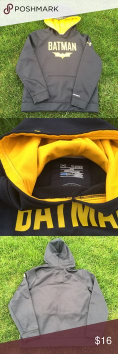 """Under Amour Batman Hoodie Under Armour boys Batman Hoodie.  Hoodie is a pullover with a pocket in front.  There is a little wear on the """"Batman"""" in front as shown in picture. Otherwise, in very GOOD used condition.  No marks, stains or piling! From a smoke and pet free home!  20% off all bundles! Under Armour Shirts & Tops Sweatshirts & Hoodies"""