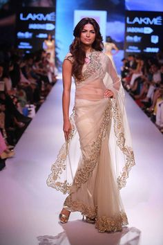 This is such a wearable and elegant saree, don't you think. Seen at Lakme Fashion Week. See more such outfits on www.frugal2fab.com