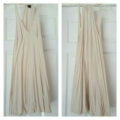 Ivory razor back dress low cut front Flirty is the name of the game with this dress. Low cut front. Dress gathers at the bottom and has balloon style cut at bottom of dress. Moda International Dresses Midi
