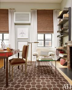 Nate Berkus masked the awkward placement of two small, low windows with high-set blinds in his NYC bedroom.