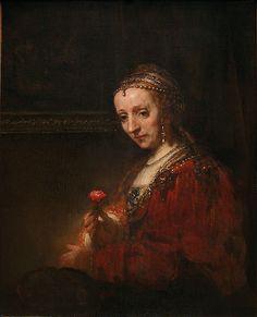 """Woman with a Pink"" - Rembrandt van Rijn"