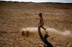 The Saharawi refugee camp Smara.Sahrawi child playing in the desert.January 2008 by Stefano Montesi from the archive buenavistaphoto. Western Sahara, Street Photo, Kids Playing, Camping, Children, January, Archive, Campsite, Young Children