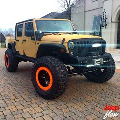Orange Wheels (rims) on a Jeep