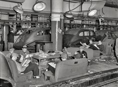 "January 1937. Flint, Michigan. ""Sit-down strikers. Fisher Body plant No. 3."" The labor action that led to the unionization of the American auto industry. Note the ""sleeping car"" at right. Photo by Sheldon Dick"