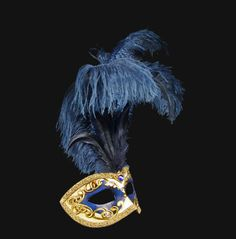 One of our classic eye mask with a distinctive venetian gold-tone detail enrich with feathers. A fun twist on the label�s classic styling.