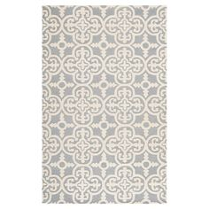 Anchor your living room seating group or define space in the den with this artfully hand-tufted wool rug, featuring an exotic tile motif for eye-catching app...
