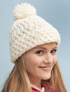 Free knitting pattern for aran cable hat with pompom