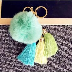 Pom-Pom Tassel Keychain New mint green pom-pom keychain or charm with three attached tassels: lime green, turquoise, and yellow. With gold detail. Accessories Key & Card Holders