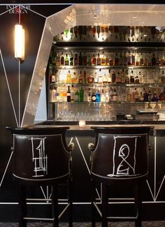 Lauren Rottet's design for the bar at the Surrey Hotel in New York City features a Chanel-inspired black-and-white lacquered wall treatment.