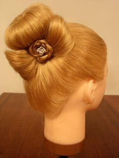 For long hair... Bun, with a braid around it, and a bow on the side.