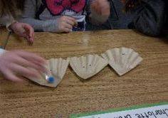 Children make oysters out of coffee filters at Central Elementary in Annapolis, Maryland.