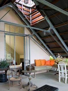steel beam roof truss w/ tall+slender metal frame french doors.