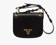 Prada Pionnière calf leather bag Detachable adjustable leather shoulder strap embellished with metal studs Gold-plated hardware Metal lettering logo Magnetic button closure One inside pocket Nappa leather lining
