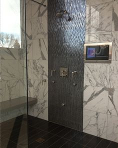 Travertine Shower With An Accent Of Glass Mosaic Tile