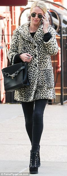 A walk on the wild side: She'd pulled on a plush leopard print coat for her day out...