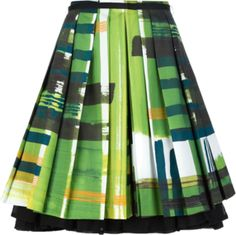 Green cotton skirt from Eggs featuring a double layered pleated design, a concealed rear zip fastening, an all over abstract print and a contrast black under layer.