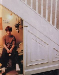 Harry Potter, under the stairs in his cupboard.