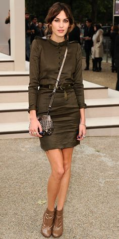 Alexa Chung  topped her button-down dress with a studded bag and patent booties for the Burberry Spring 2011 show.