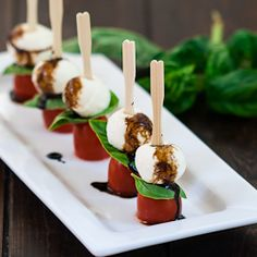 Mini Caprese Salad Bites 2 cups mini bocconcini pieces 2 cups cherry tomatoes a bunch of fresh basil salt and pepper to taste 1 cup balsamic vinegar toothpics Mini Appetizers, Appetizer Recipes, Wedding Appetizers, Caprese Appetizer, Shower Appetizers, Christmas Appetizers, Cocktail Party Appetizers, Elegant Appetizers, Christmas Brunch