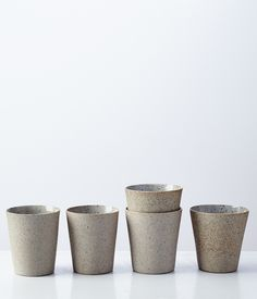 Image of stoneware + porcelain cup