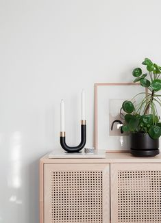 The form language of the Kaari candle holder combines a smart idea with Nordic simplicity and functionality! Kaari is made up of a round wooden u-shaped stem, a brass candle holder and a foot that keeps the candle holder firmly standing up.  The product's form had its inspiration from an umbrella handle!