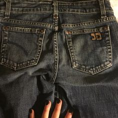 Joe jeans dark wash boot cut jeans Dark wash boot cut jeans. There are worn marks on the bottom of the backside. It's a bit faded and has tear marks originally from the manufacture. Joe's Jeans Jeans Boot Cut
