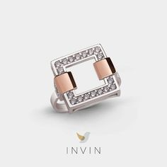 ANTWERP RING Stylish Geometric Silver and 9kt. Rose Gold Ring with Cubic Zirconia. Striking squares bring to mind the world famous Museum ann de Stroom in Antwerp, while sparkling cubic zirconia evokes the city's sumptuous Renaissance architecture. This is a bold, sophisticated piece, equally graceful and graphic, like the city from which it takes its name.