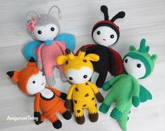 Amigurumi dolls in animalistic costumes, butterfly pattern; links to dragon, giraffe, ladybug, and fox crochet patterns