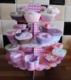 Cupcake Candles - inspiration, saw some silicone molds on amazon that would be perfect for something like this. Grate some wax on top, whipped wax and wax cut out shapes for embellishment
