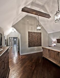 Oakley Home Builders traditional-bedroom - Wall decor and bed frame.  Wonder if we could beam our ceiling...