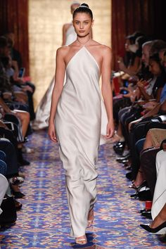 Brandon Maxwell | Spring 2017 Ready-to-Wear Fashion Show | Sleek cream halter dress | Model: Taylor Hill