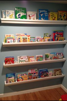 *Play Room Organization* DIY book shelves: made from plastic rain gutters