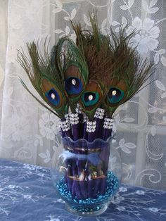 25 Peacock Feather Pen Favors with BLING in your choice of colors - 50% DEPOSIT LISTING. $56.00, via Etsy.